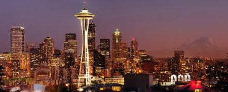 Striking panoramic image of Seattle skyline with Mount Rainier glowing at sunset