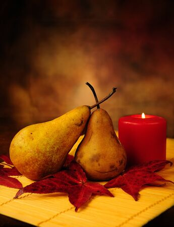 candles in dark: Abstract still life of a pair of pears under candle light in autumn