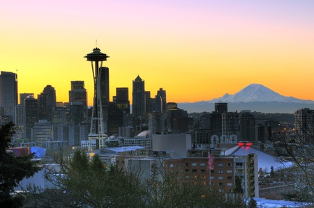 Emerald city of Seattle waking up in a bright colorful sunrise, Mt Rainier towering in the background