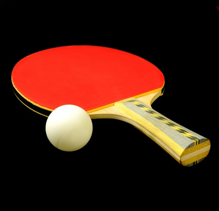 ping pong: Ping pong or table tennis paddle and ball over black
