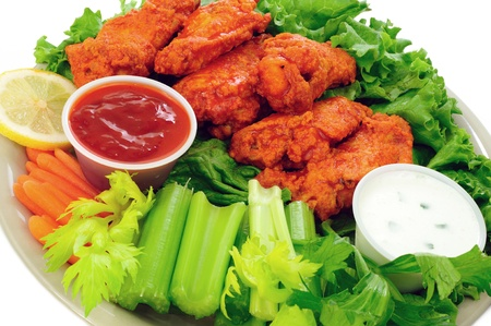 Spicy buffalo chicken wings served with hot and sour dip and crispy veggies