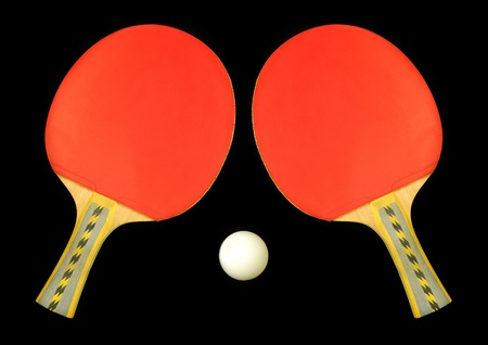 Table tennis double paddle and ball over black photo