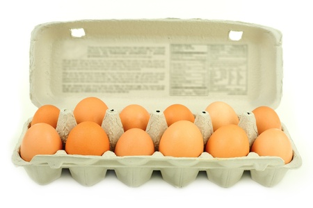 Fresh brown country eggs packged in a dozen carton photo