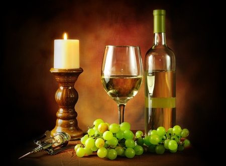 Classic still life image of white wine with green grapes