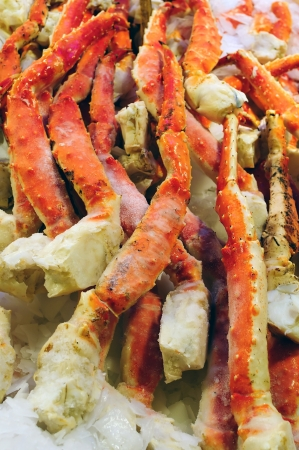 Fresh Alaskan dungeness crab legs on display in a market
