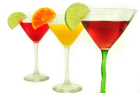 Assorted cocktail drinks in a row with citric slices photo