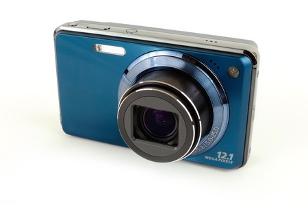 Blue modern digital point and shoot camera isolated over white