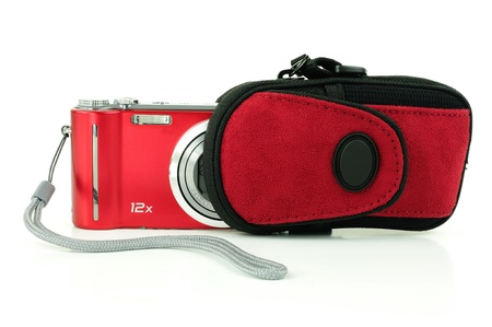 Small red compact digital camera being stored in a pouch for protection