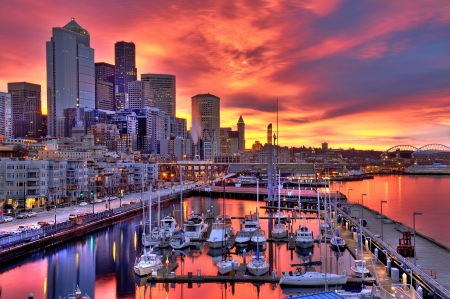 High dynamic image of Seattle skyline in dramatic sunrise colors across pier-66 waterfront Stock Photo