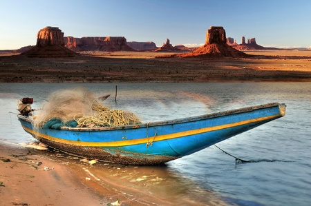river bank: Indian country boat tied at Navajo river bank in Monument Valley Stock Photo