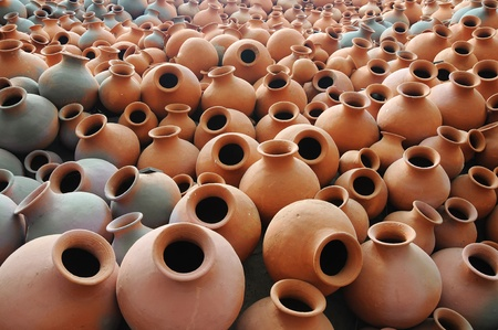 Many earthen pots kept for drying in the sun