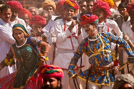 PUSHKAR, INDIA - NOVEMBER 7: Rajasthani folk dancers in colorful ethnic attire perform at the Pushkar cattle fair on November 7, 2011 in Pushkar, Rajasthan, India.