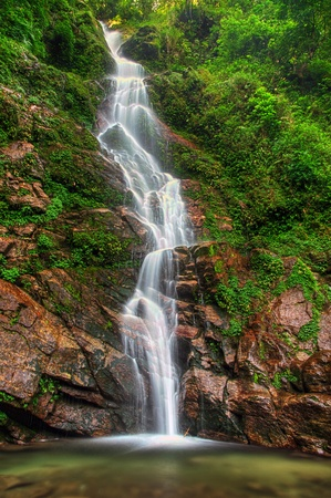 Majestic Rimbi waterfall in Kanchenjunga National Park in Sikkim photo