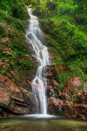 source: Majestic Rimbi waterfall in Kanchenjunga National Park in Sikkim Stock Photo