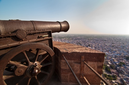 Huge cannon of Mehrangarh fort overlooking the blue city of Jodhpur photo