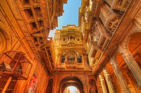 The famous Patwon ki Haveli mansion made of yellow limestone glowing in sunlight