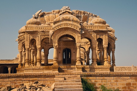 jainism: The royal cenotaphs of historic rulers at Bada Bagh in Jaisalmer made of yellow sandstone. Stock Photo