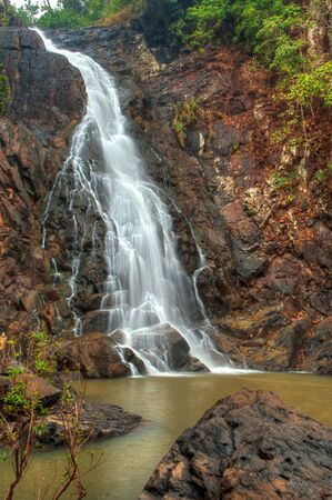 source: Beautiful jungle waterfall in Simlipal tiger reserve national park vertical image