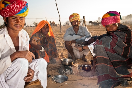 PUSHKAR, INDIA - NOVEMBER 7, 2011: Camel traders attend the Pushkar Cattle Fair on November 7, 2011 in Pushkar, Rajasthan, India. Pilgrims and camel traders flock to the holy town for the annual fair.