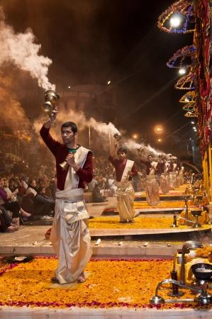VARANASI, INDIA - FEBRUARY 18, 2012: Unidentified Hindu priests perform religious Ganga Aarti ritual on Maha Shivaratri festival on February 18, 2012 at Varanasi, Uttar Pradesh, Central India.