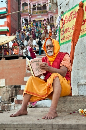 VARANASI, INDIA - FEBRUARY 20, 2012: A Hindu brahmin monk reads sacred hindu scriptures on the auspicious Maha Shivaratri festival on February 20, 2011 at Varanasi, Uttar Pradesh, India.