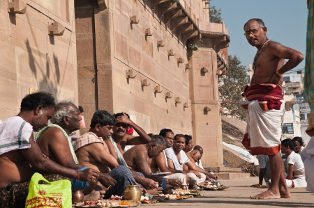VARANASI, INDIA - FEBRUARY 19, 2012: Hindu brahmins perform prayer ceremony under guidance of a priest on the auspicious Maha Shivaratri festival on February 19, 2011 at Varanasi, Uttar Pradesh, India.
