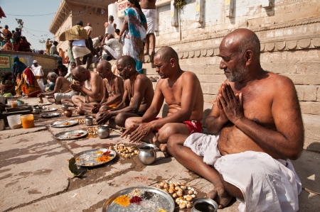 VARANASI, INDIA - FEBRUARY 20, 2012: Hindu brahmins perform prayer ceremony on the auspicious Maha Shivaratri festival on February 20, 2011 at Dasashwamedh ghat in Varanasi, Uttar Pradesh, India.