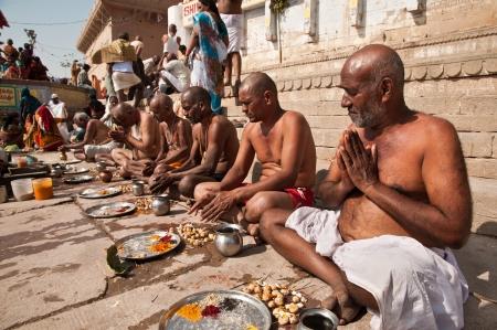 VARANASI, INDIA - FEBRUARY 20, 2012: Hindu brahmins perform prayer ceremony on the auspicious Maha Shivaratri festival on February 20, 2011 at Dasashwamedh ghat in Varanasi, Uttar Pradesh, India. Editorial