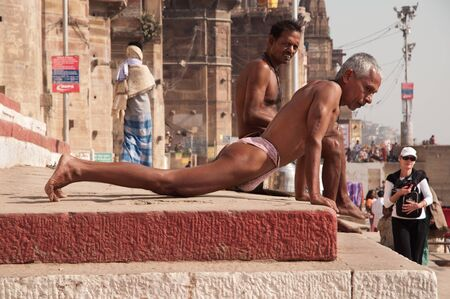 Rural Indian wrestlers perform excercises at the Ganges river bank on February 20, 2011  in Varanasi, Uttar Pradesh, India