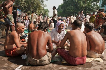 KOLKATA, INDIA - OCTOBER 15: Hindu pilgrims perform prayer on the auspicious Mahalaya Tarpan ceremony on October 15, 2012 at Babughat in Kolkata, West Bengal, India.
