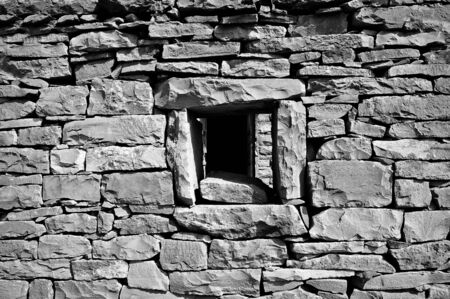 broken brick: Very old and broken brick wall with a window in it