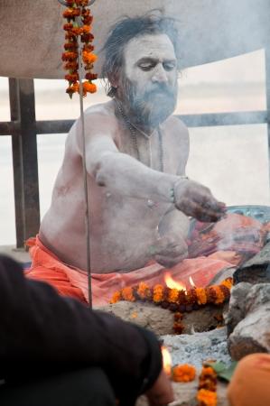VARANASI, INDIA - MARCH 10: A hindu saint performs yagna prayer rituals of Lord Shiva on the auspicious Maha Shivaratri festival on March 10, 2013 at Varanasi, Uttar Pradesh, India. Stock Photo - 18646848