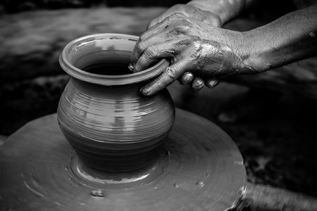 clay craft: Black and white stricking image of a potter Stock Photo