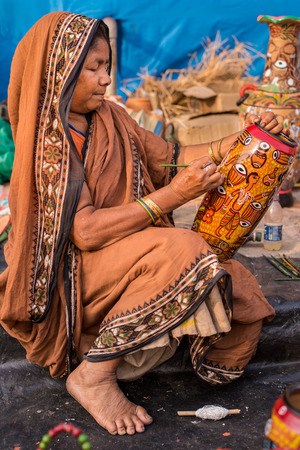 craftswoman: KOLKATA, INDIA - DECEMBER 7: An Indian craftswoman creates colorful handicraft items for sale during the annual State Handicrafts Expo 2014 on December 7, 2014 in Kolkata, West Bengal, India.