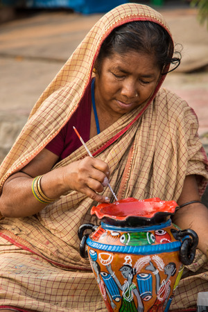 craftswoman: KOLKATA, INDIA - DECEMBER 11: An Indian craftswoman creates colorful handicraft items for sale during the annual State Handicrafts Expo 2014 on December 11, 2014 in Kolkata, West Bengal, India. Editorial