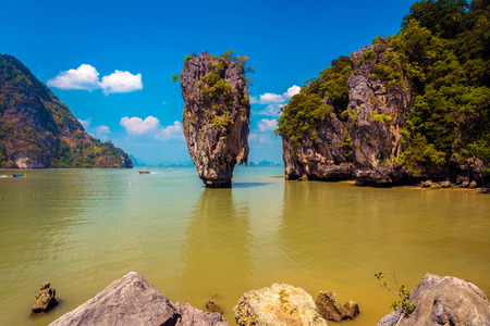 james: Khao Phing Kan featuring the 20m tall islet known as Ko Tapu in Phang nga bay in thailand. It is also known as the James Bond island after the 1974 James Bond movie - The Man with the Golden Gun was shot here.