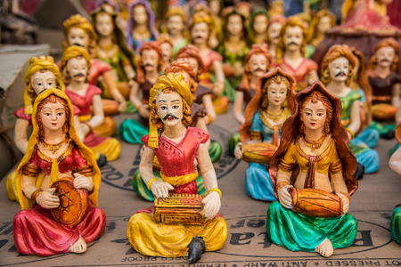indian fair: Beautiful clay dolls of miniature musicians performing in a band of classical music