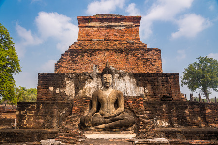 lord buddha: Statue of seated lord Buddha at ancient temple of Wat Mahathat in Sukhothai, Thailand