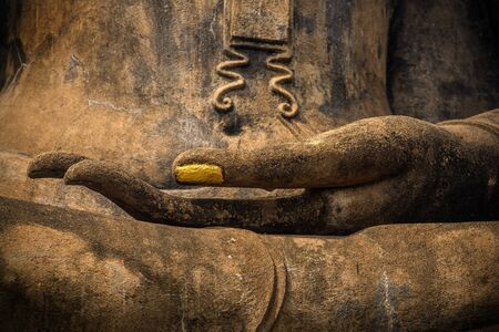 lord buddha: Closeup of the hand of Lord Buddha with gold leaf applied on finger nail.