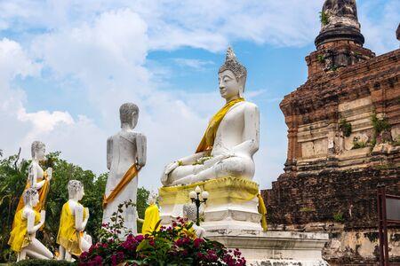Statue of Lord Buddha preaching his disciples at Wat Yai Chaimongkon in Ayuthaya, Thailand.