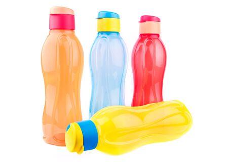 Colorful fridge pet bottles isolated over white background