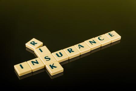 letter blocks: Business concept of risk management by insurance using letter blocks