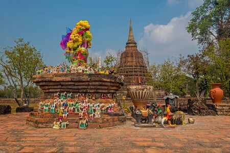worshipped: Idols and stones being worshipped with flowers at Wat Mahathat in Sukhothai, Thailand.