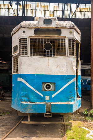 nonpolluting: Historic electric tram of Kolkata standing at a depot.