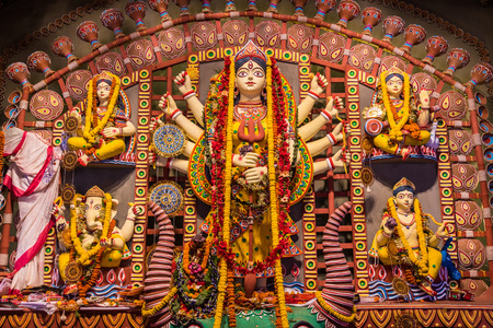 worshipped: Beautiful clay idols of Durga, lakshmi, saraswati, ganesha and kartik being worshipped during Hindu festival of Durga Puja.