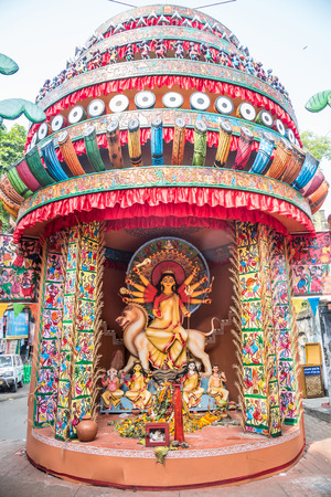 hindu temple: KOLKATA, INDIA - OCTOBER 23, 2015: Beautifully decorated Pandal of Goddess Durga at Durga Puja festival in Kolkata, West Bengal, India. Durga Puja is the biggest religious festival of Hinduism. Editorial