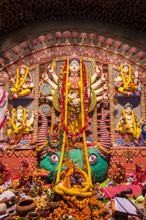 worshipped: Vertical image of Hindu Gods and Goddesses being worshipped during Durga Puja festival