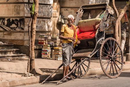 west bengal: KOLKATA, INDIA - OCTOBER 31: An Indian Rickshaw puller waits for passengers on October 31, 2015 at College Street in Kolkata, West Bengal, India. Editorial