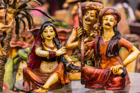indian fair: Beautiful clay dolls of miniature villagers performing their daily chores. Stock Photo