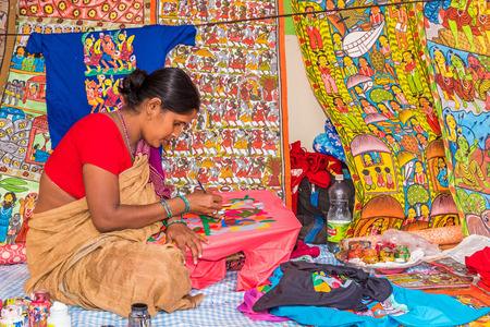 craftswoman: KOLKATA, INDIA - NOVEMBER 28: An Indian craftswoman paints on colorful handicraft items for sale during the annual State Handicrafts Expo 2015 on November 28, 2015 in Kolkata, West Bengal, India. Editorial